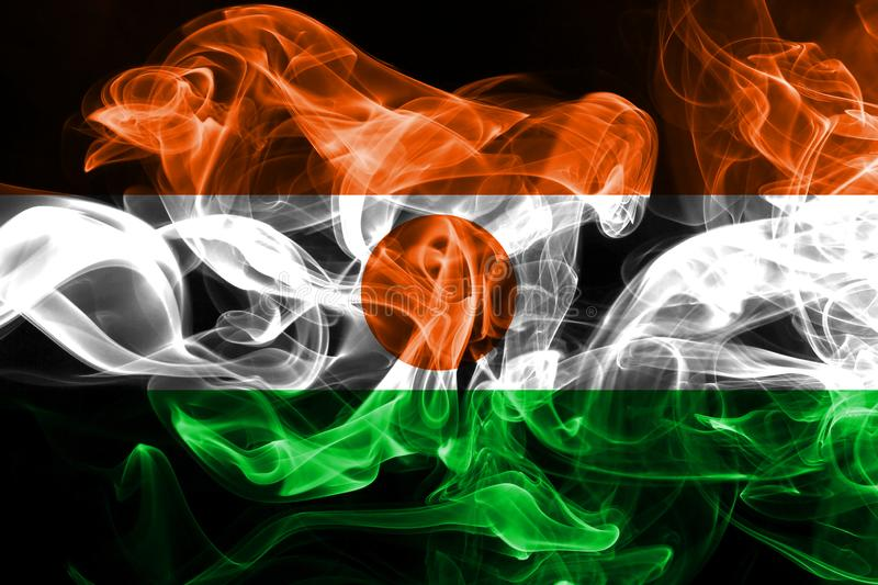 National flag of Niger made from colored smoke isolated on black background.  royalty free stock photos