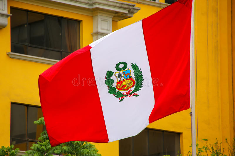 National flag of Peru flying in a wind. The flag of Peru was adopted by the government of Peru in 1824 stock photos