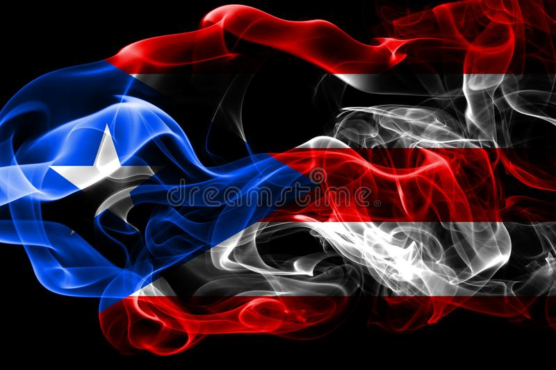 National flag of Puerto Rico made from colored smoke isolated on black background. Abstract silky wave background. National flag of Puerto Rico made from stock photos