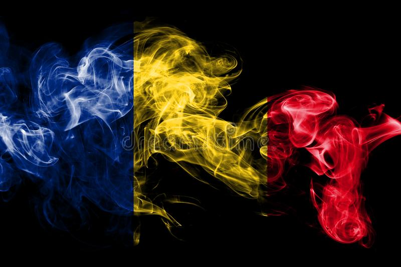 National flag of Romania made from colored smoke isolated on black background. Abstract silky wave background. National flag of Romania made from colored smoke stock photography