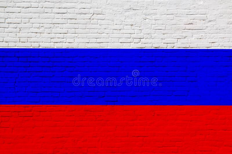 National flag of Russian federation painted on brick wall. National flag of Russian federation painted on a brick wall stock photos