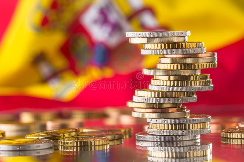 National flag of spain and euro coins - concept. Euro coins. Eur royalty free stock image