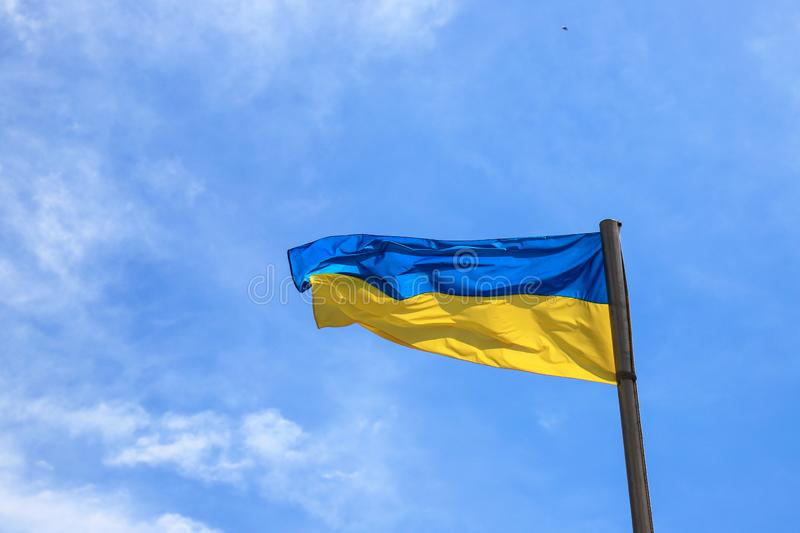 National flag of Ukraine flies in the blue sky. Yellow blue Ukrainian flag. Independence Day, Constitution, National Holiday stock photos