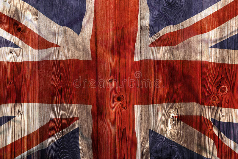National flag of United Kingdom, wooden background stock photo