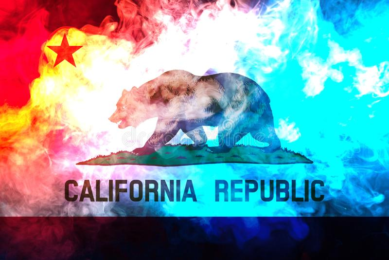 The national flag of the US state California in against a gray smoke on the day of independence in different colors of blue red stock image