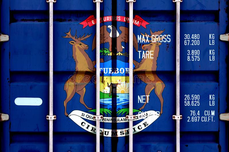 The national flag of the US state Michigan in a container doors on the day of independence in different colors of blue red and. Yellow. Political and religious stock image