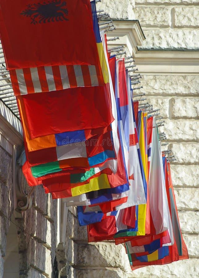 National flags flying in Vienna Austria. Flags representing many nations fly at the Wiener Kongresszentrum Hofburg BetriebsgesmbH Heldenplatz in Vienna - Wien royalty free stock images
