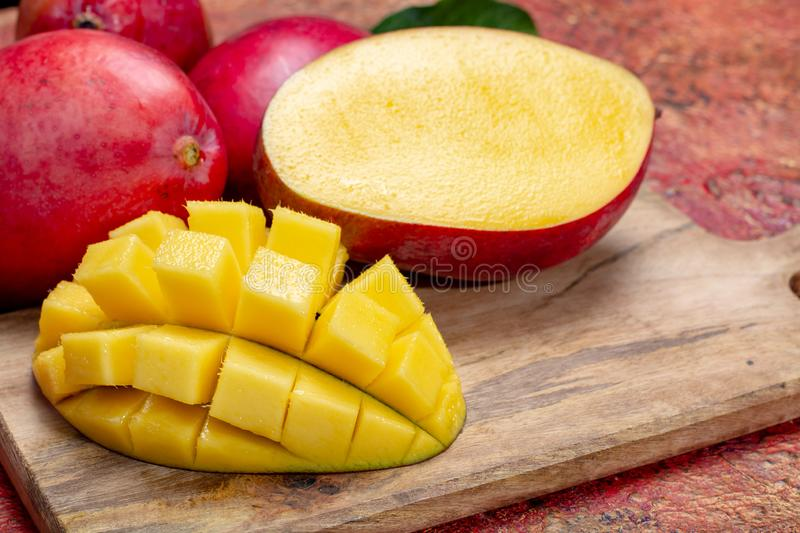 National fruit of India, Pakistan, and Philippines tropical organic ripe red mango ready to eat. Close up stock images
