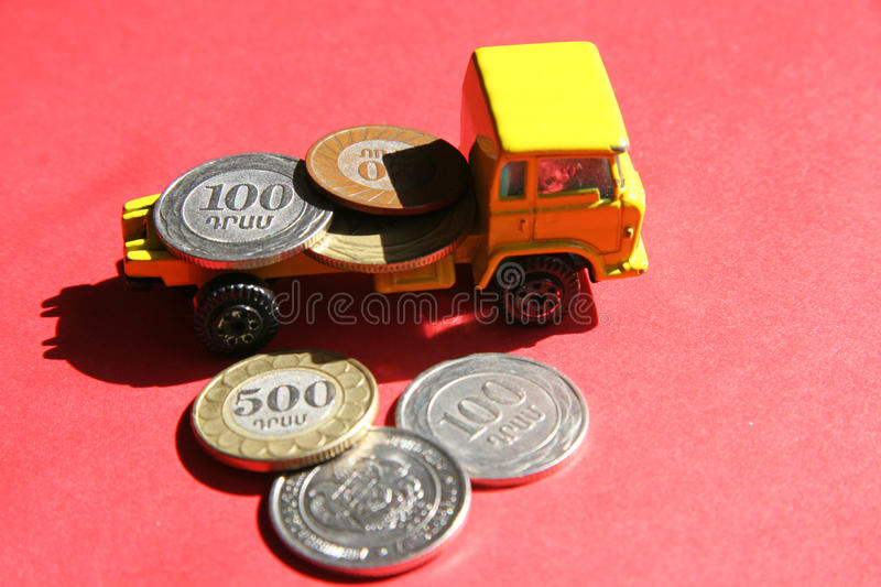 National funding of Armenia. Armenian coins in a truck on a red background stock image