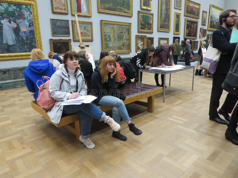 National Gallery, London. People redrawing and watching paintings. Must go places for tourists stock photos