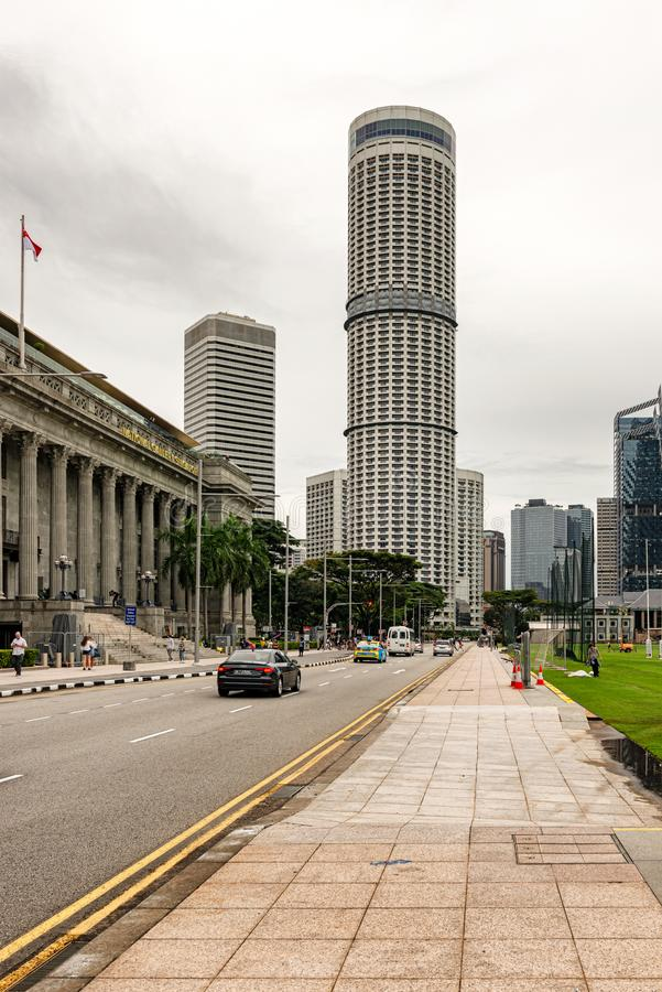 National Gallery in Singapore and the buildings at Raffle's ci. Singapore - January 14, 2018: Tourists and the traffic in front of National Gallery in royalty free stock photos