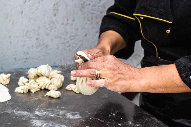 National Georgian cuisine Khinkali metal background Cook prepares khinkali kitchen Top view raw meat dough dish uncooked Street fo royalty free stock photos