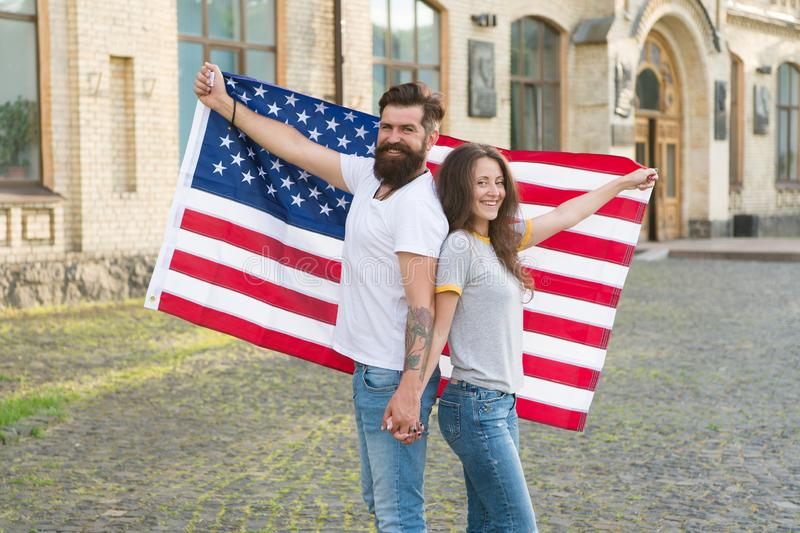 National holiday. Bearded hipster and girl celebrating. 4th of July. American patriotic people. American citizens couple stock photos