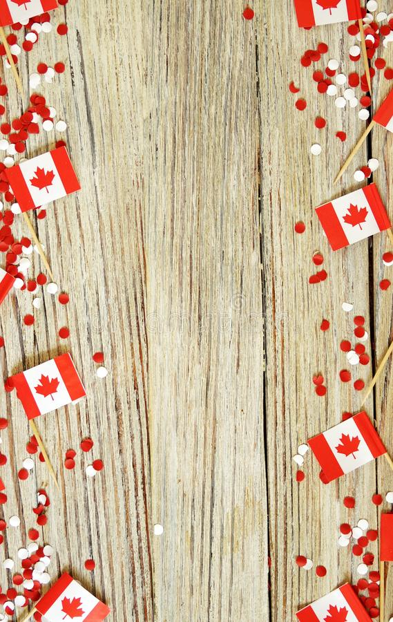 The national holiday of July 1- happy Canada day , Dominion day, the concept of patriotism, independence and memory, a place for. Text. white red confetti and royalty free stock images