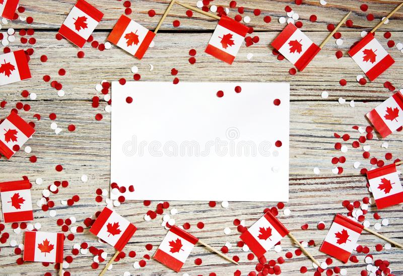 The national holiday of July 1- happy Canada day , Dominion day, the concept of patriotism, independence and memory, a place for. Text. white red confetti and royalty free stock photography