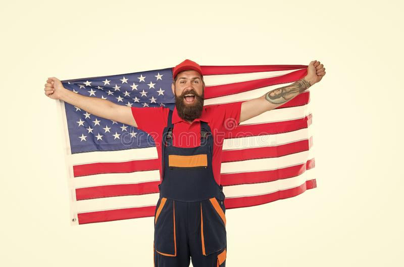 National holiday. Worker celebrate independence day. Work visa USA. Man hold american flag. Repair and renovation. Guy royalty free stock images