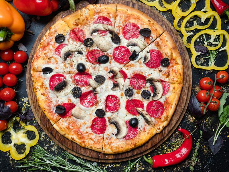 Italian meal homemade pizza food pepperoni olives stock image