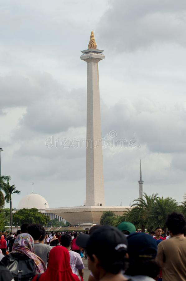 National Monument of Indonesia standing over the crowd of people stock photography