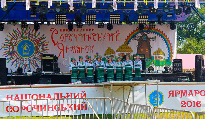 National musical group acts on Sorochintsy Fair. Velyki Sorochyntsi, Ukraine -August 20, 2016: National musical group acts on Sorochintsy Fair in Velyki royalty free stock photos