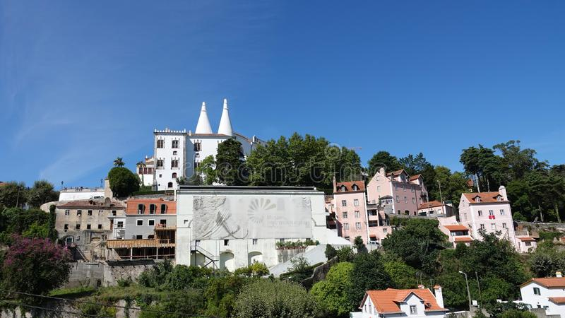 National palace in Sintra town in Portugal. Palacio Nacional de Sintra with the twin conical chimneys dominates the skyline. It is built in a mixture of Gothic stock photos