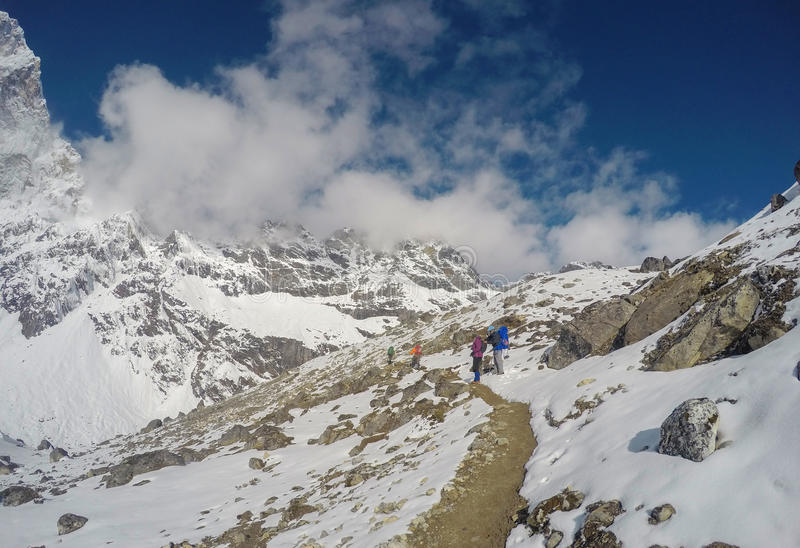 National Park in Himalaya. White snow and rocky peaks. Nepalese severe winter. Mountain landscape. Trek to mountain Sagarmatha. National Park in Himalaya. White stock photography