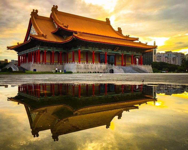 National Performing Arts Center, Taipei, Taiwan. Facade of National Performing Arts Center reflecting in pool in Taipei, Taiwan at sunset stock images