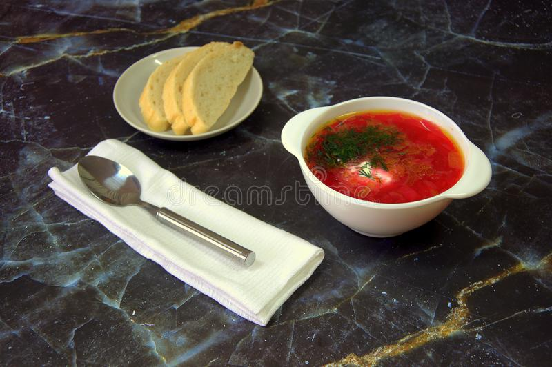 National Russian soup Red borsch with sour cream and herbs royalty free stock photography