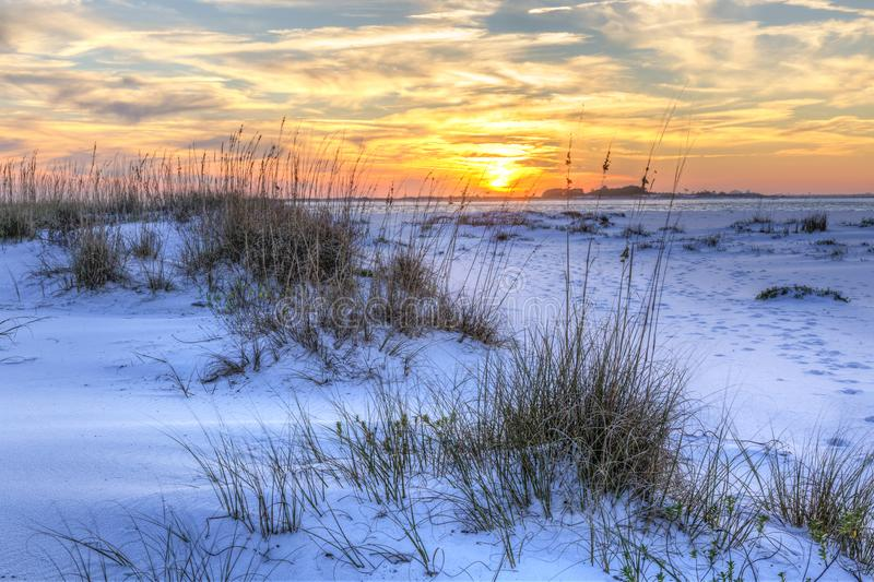National Seashore Seaoats Sunset. A colorful sunset over the seaoats and dunes on Fort Pickens Beach in the Gulf Islands National Seashore, Florida royalty free stock images