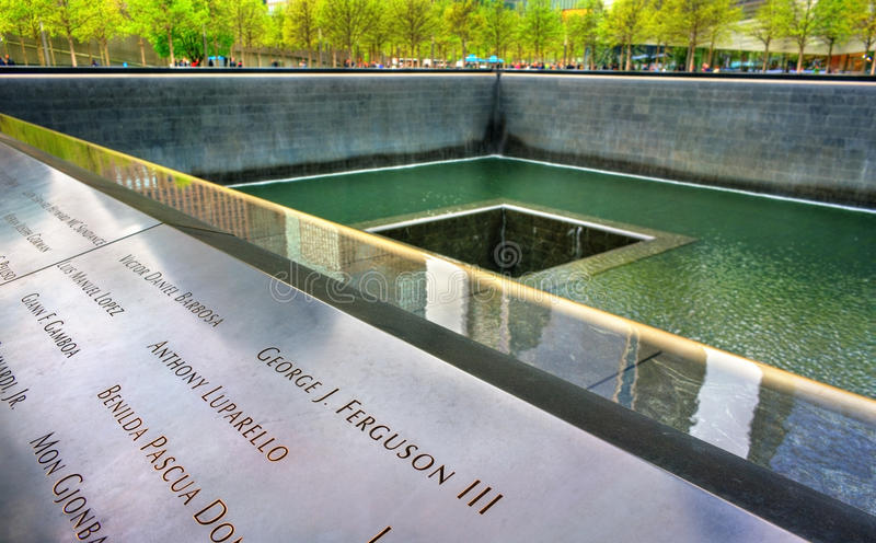 National September 11 Memorial commemorating the terrorist attacks on the World Trade Center in New York City, USA. New York City, United States - May 5, 2017 royalty free stock image