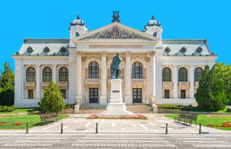 The National Theatre from Iasi, Romania. IASI, ROMANIA - AUGUST 03, 2015: The National Theatre from Iasi with statue of romanian poet Vasile Alecsandri in front stock photos