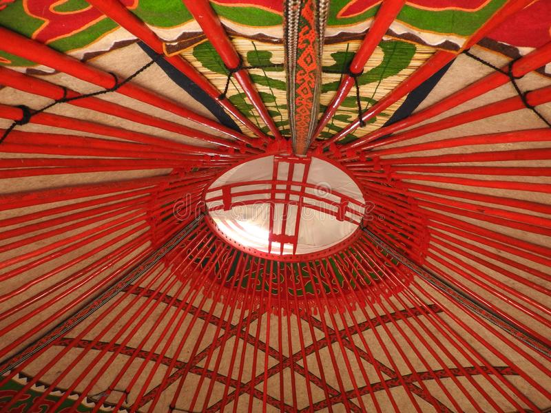 National traditional decoration of the ceiling and walls of the Mongolian Yurt.Vintage weave patterns. The decoration of the Yurt. Wooden frame with patterns stock photography