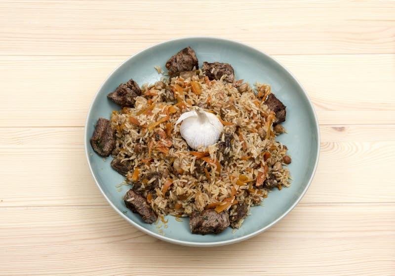 National Uzbek pilaf with meat royalty free stock image