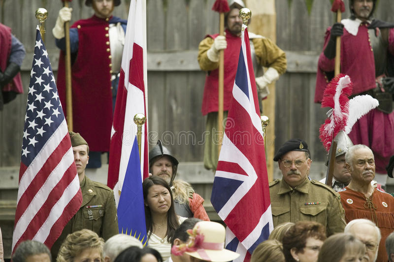 National World War II American and British Solider. Reenactors posing in front of 1607 Jamestown with English reenactors at James Fort, Jamestown Settlement as royalty free stock images