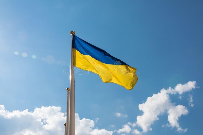 National yellow - blue flag of Ukraine. Ukrainian flag fluttering in the sky royalty free stock photos