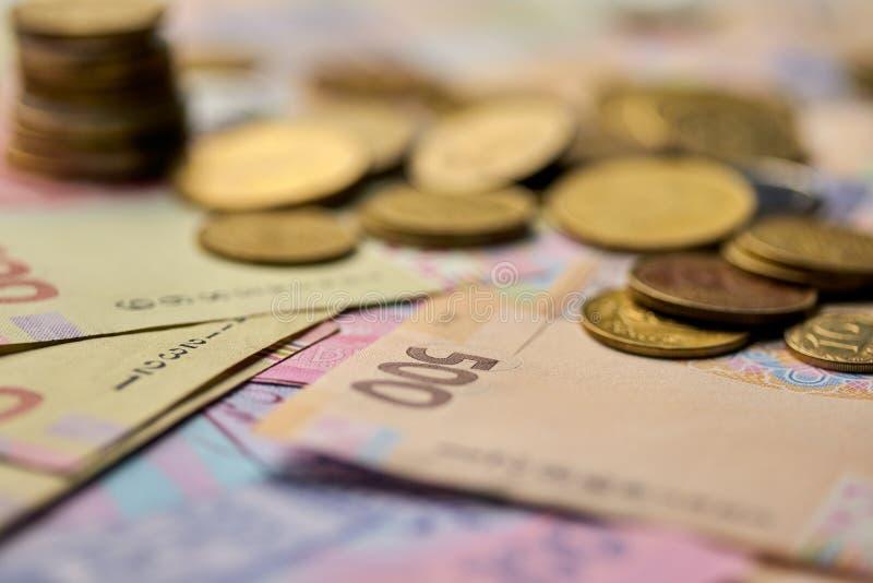 nationale valuta van het document en het ijzer de mening van het geldclose-up van de Oekraïne van contant geld stock foto
