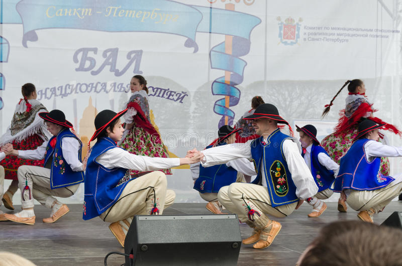 The Nationalities Ball participants: on the stage Polish folk dance ensemble `Gaik`. stock images