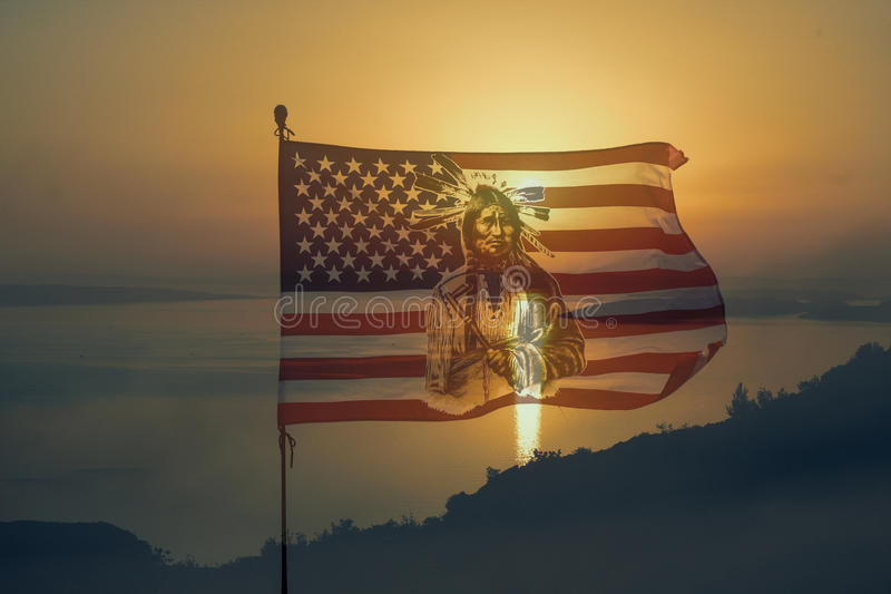Nationaly american flag with indian in sunset royalty free stock photo