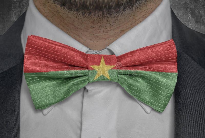 Nationellt land för flagga av Burkina Faso på dräkt för bowtieaffärsman arkivfoton