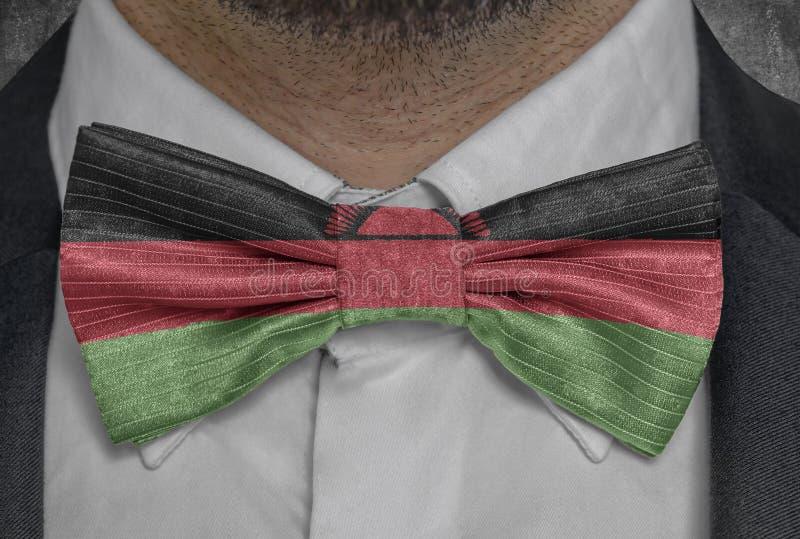 Nationsflagga av Malawi på dräkt för bowtieaffärsman royaltyfri foto