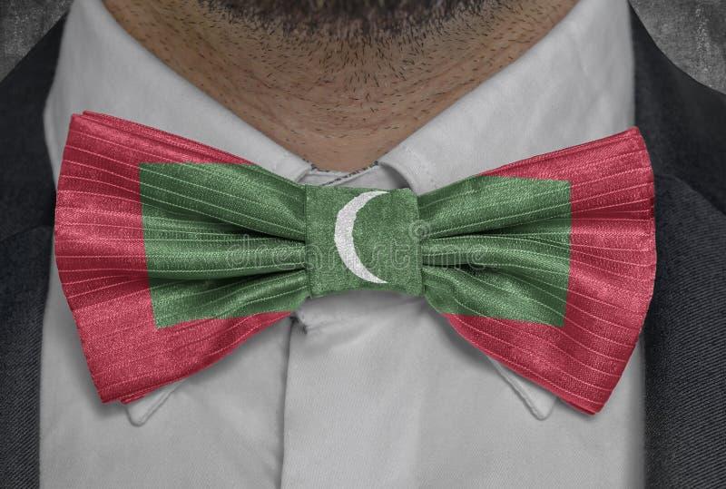 Nationsflagga av Maldiverna på dräkt för bowtieaffärsman royaltyfri fotografi