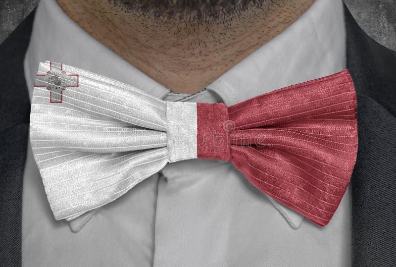 Nationsflagga av Malta på dräkt för bowtieaffärsman arkivbild