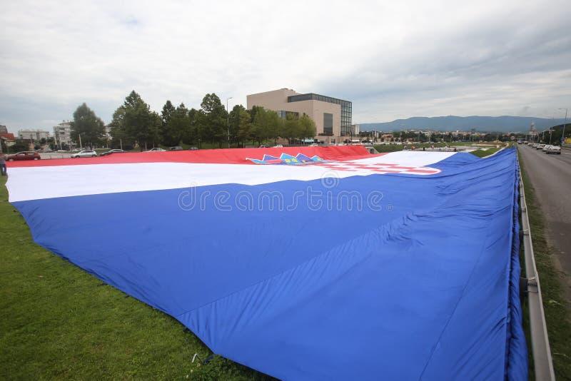 Nationsflagga på välkomnandehemceremoni fotografering för bildbyråer