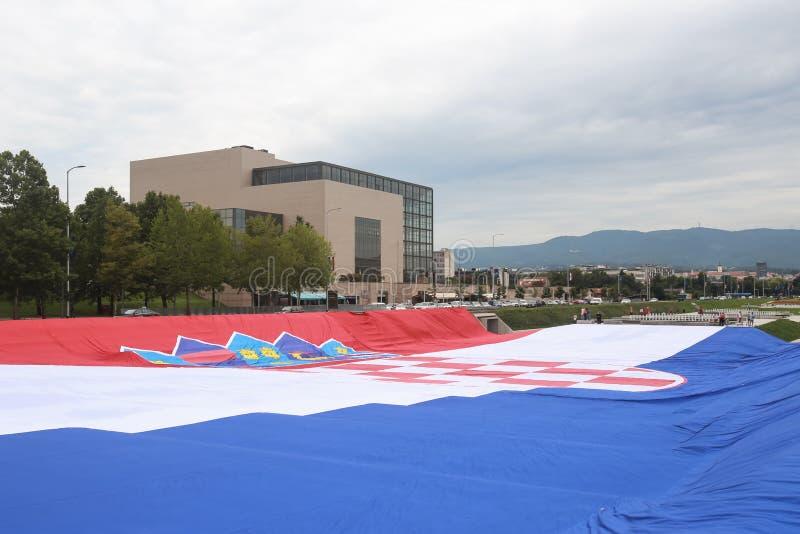 Nationsflagga på välkomnandehemceremoni royaltyfri fotografi
