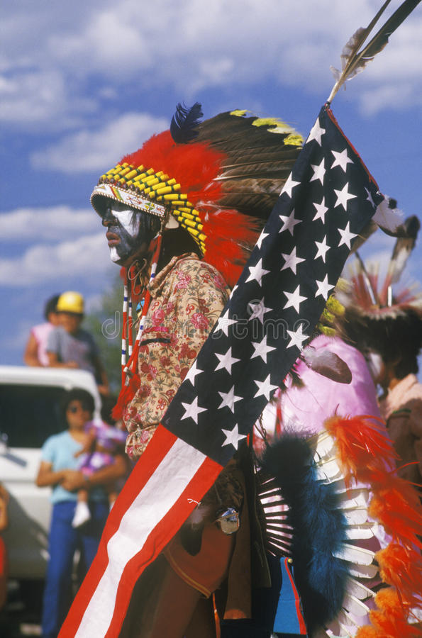 A Native American with an American flag