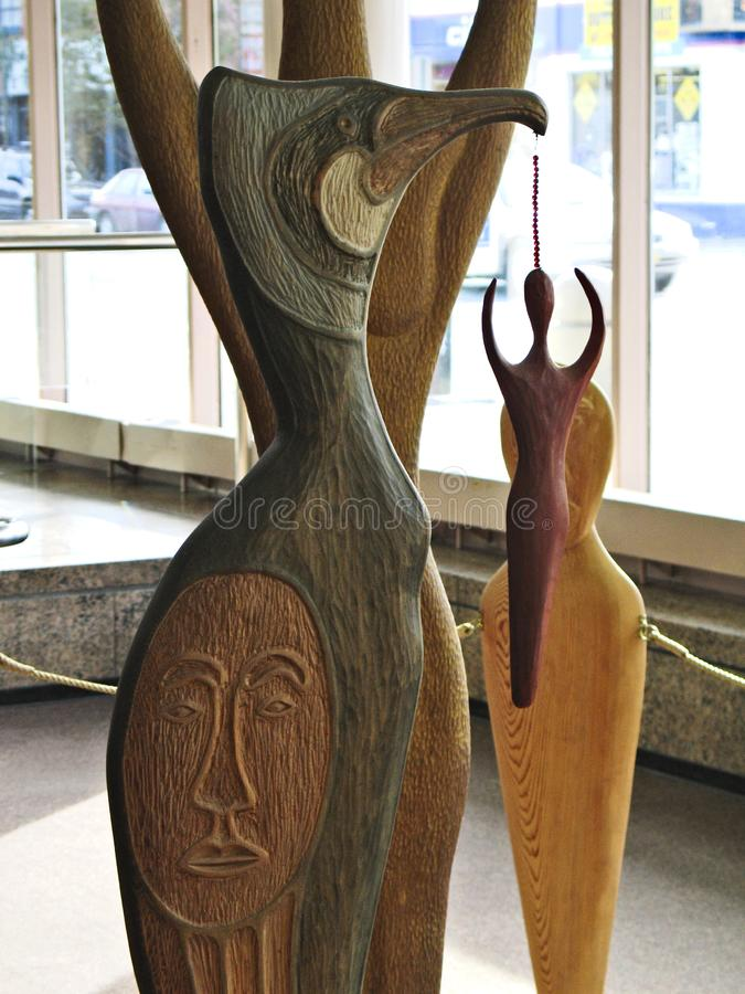 Native american artwork Volcano Woman totem sculptures by John Hoover carved in red cedar. Anchorage/USA - May 23, 2018: Native american artwork Volcano Woman stock images