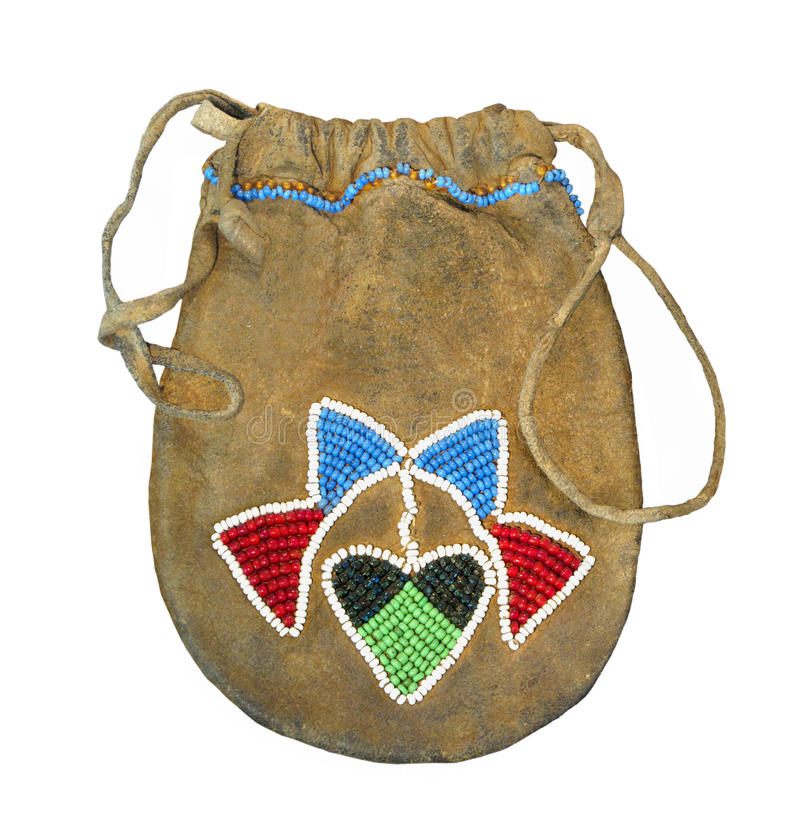 Native American beaded bag isolated. Native American Indian deerskin bag with beadwork and drawstring. Isolated on white stock images