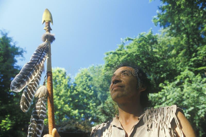 Native American Cherokee holding a spear, Tsalagi Village, Cherokee Nation, OK royalty free stock photography