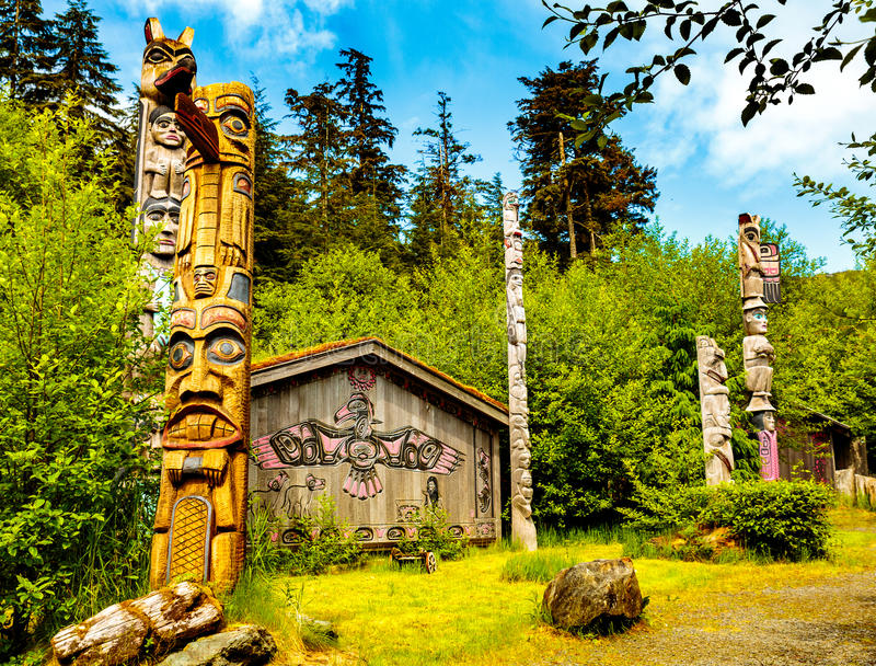 Native American Clan House and Totems royalty free stock photography