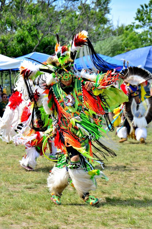 Native American Dancer. Native American performing a traditional dance during the Gateway to Nations Pow Wow, Brooklyn, New York June 8, 2014 royalty free stock images