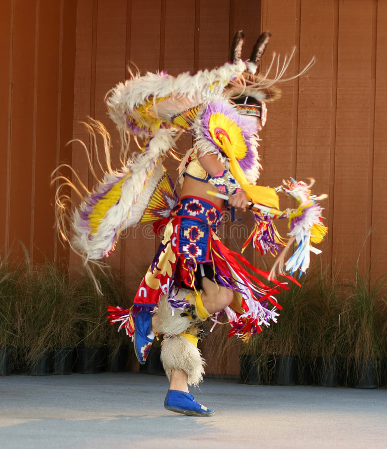 Native American Dancing 3. A Native American man doing a tribal dance